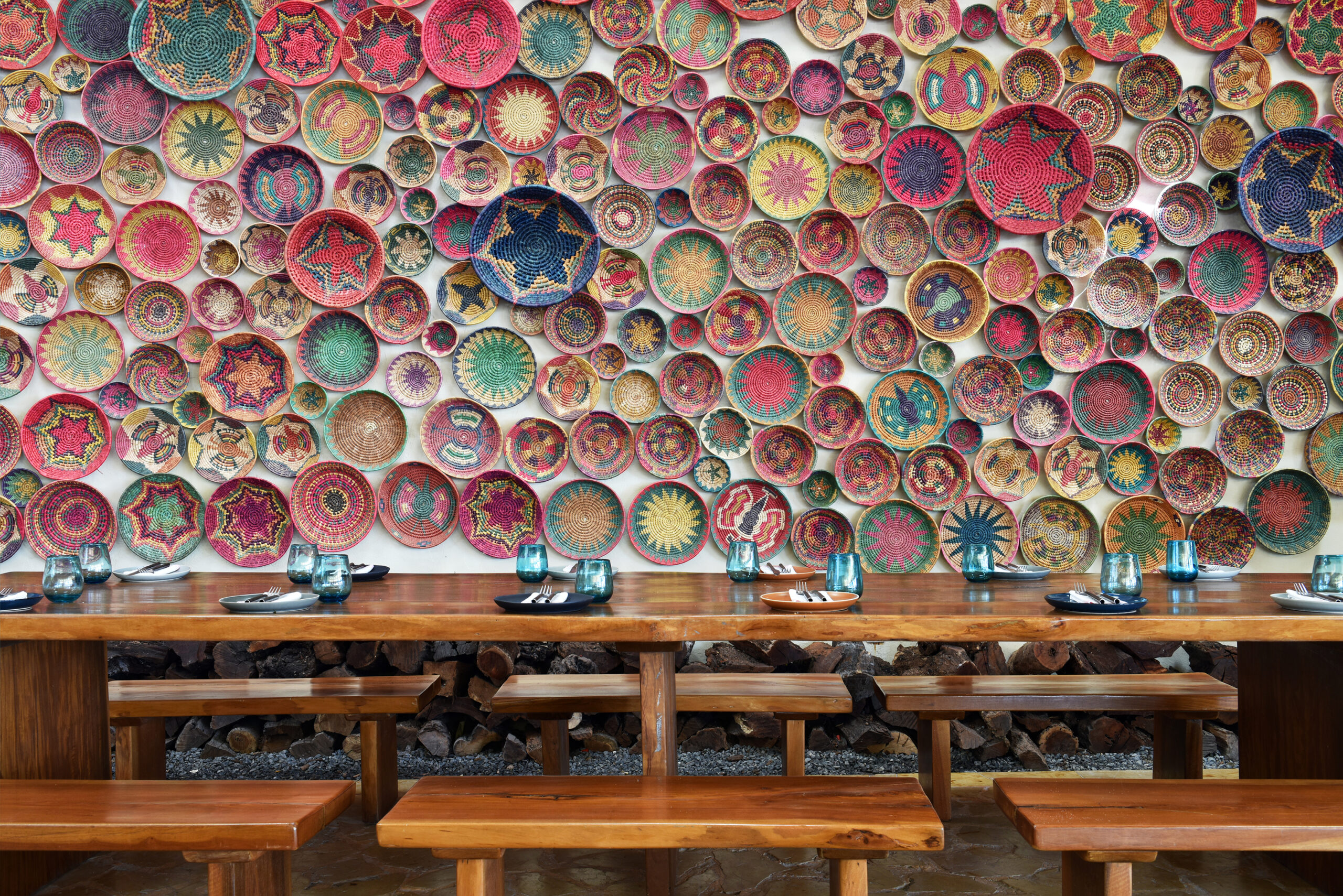 wall covered with colourful Mexican baskets