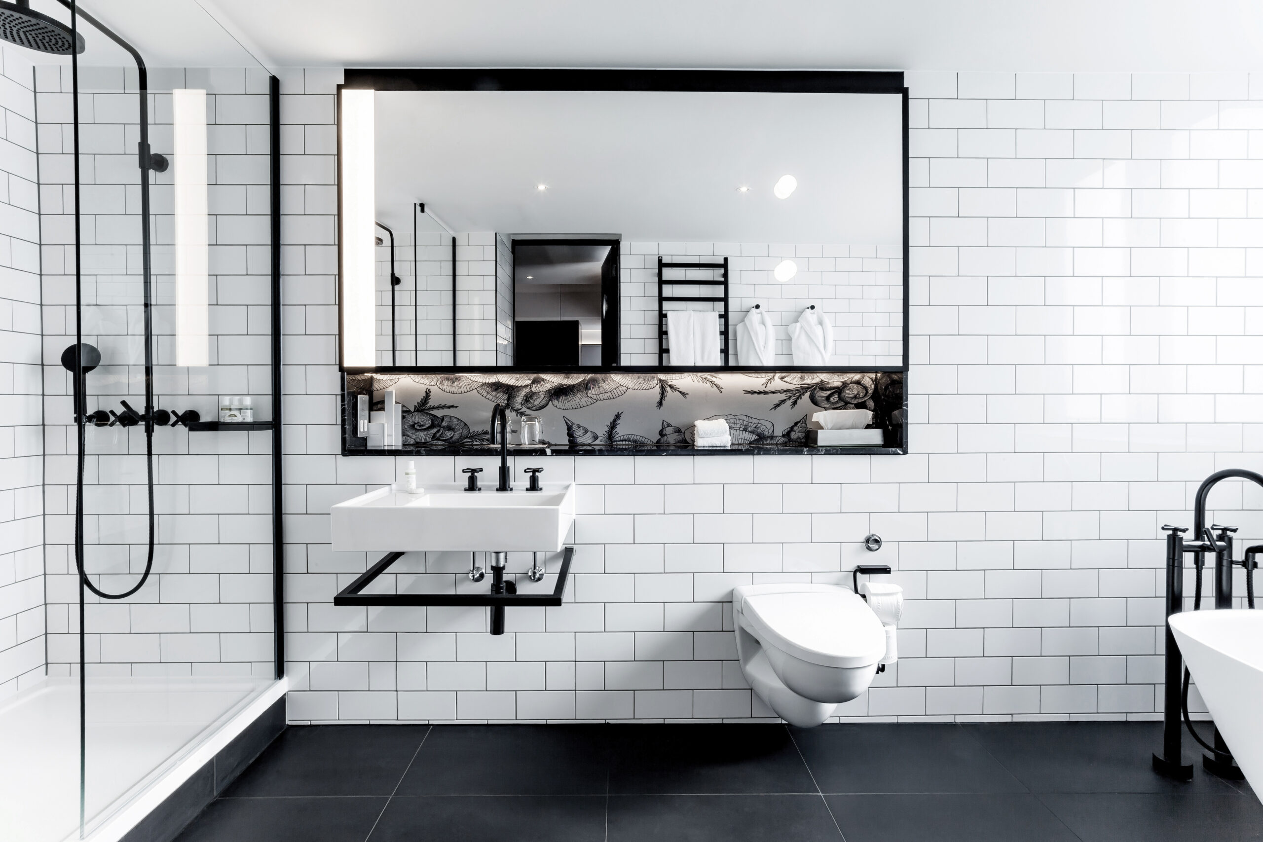 Black and white bathroom with a traditional touch