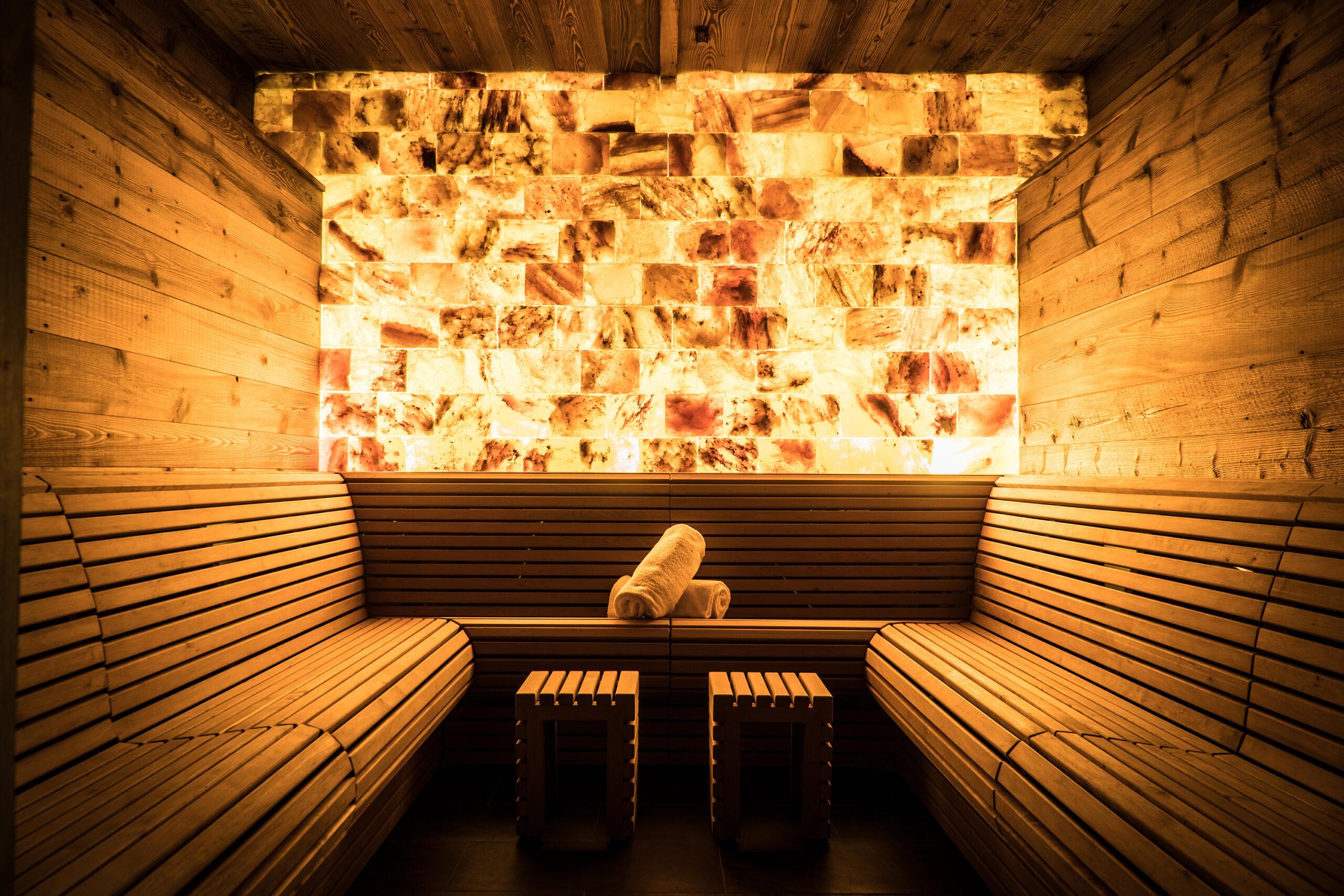 Sauna with backlit stone wall