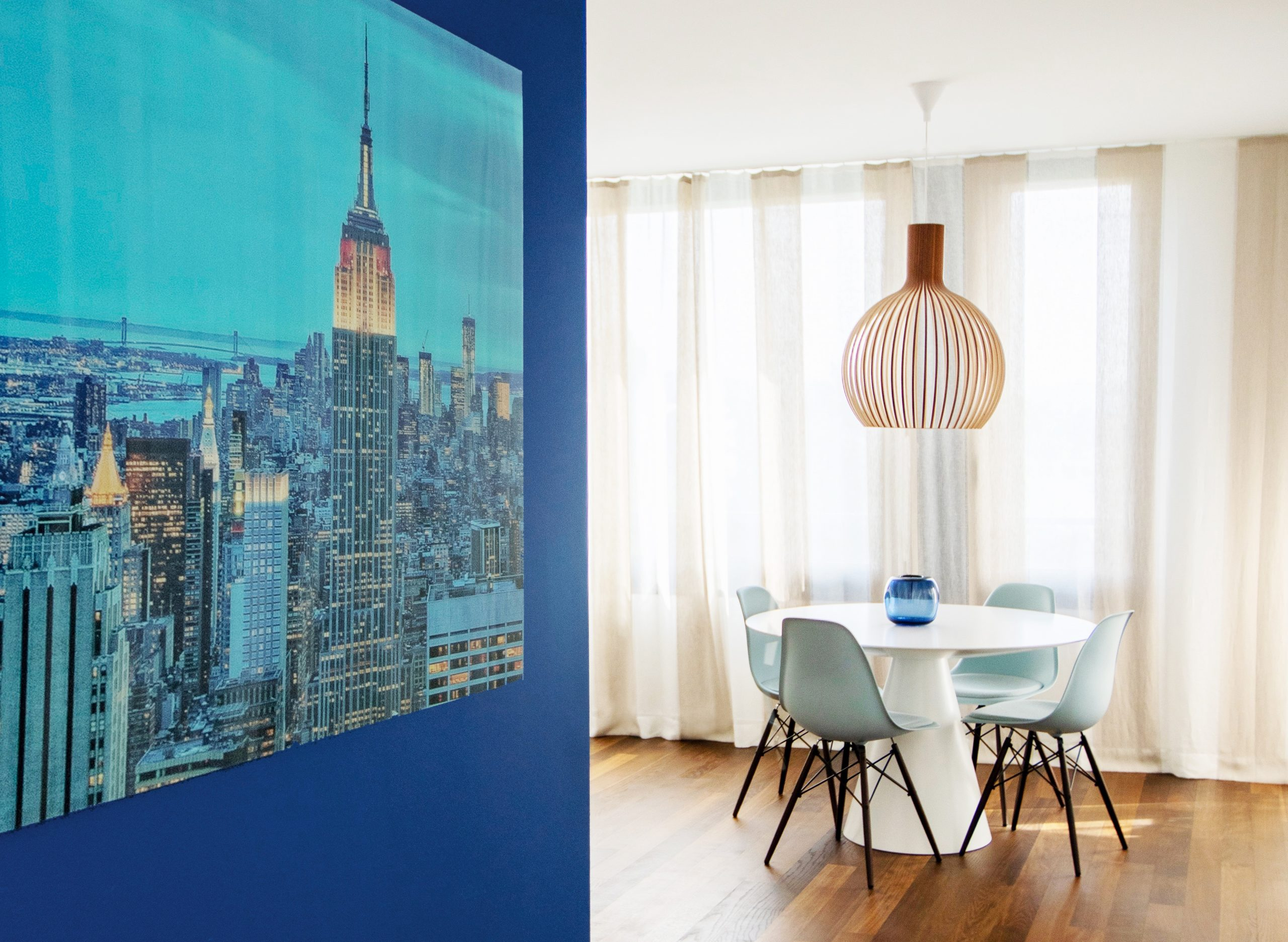 minimalistic interior with blue feature wall