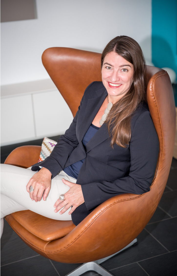 Interior Designer sitting in egg chair