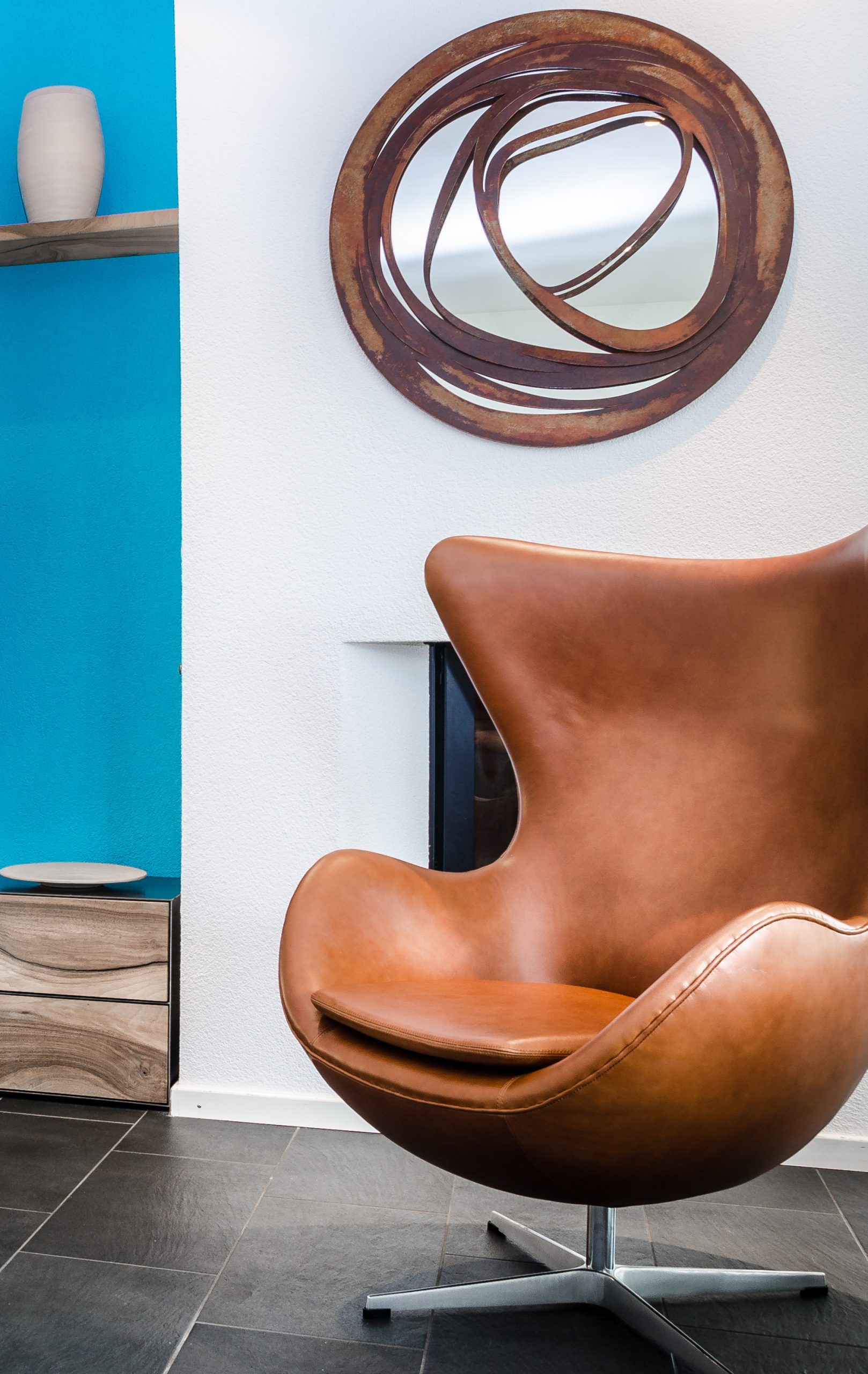 cognac egg chair and mirror