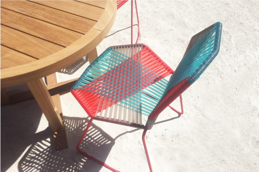 colourful chair on the sand